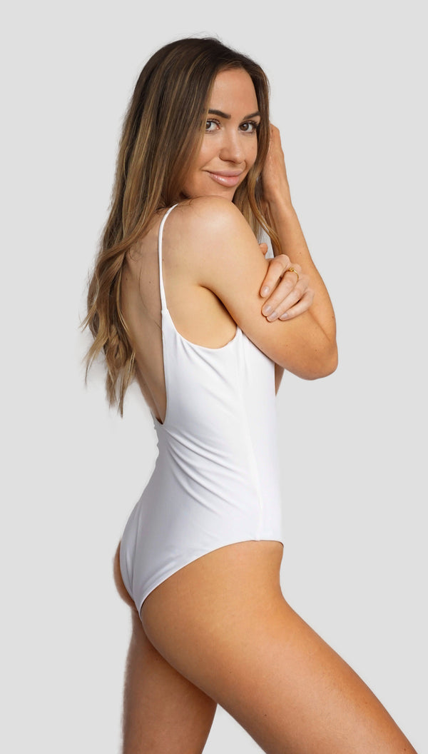 Alexandra Rabbitte wears International swimwear brand Prairie Swim classic white low back, deep v neck, curve hugging, one piece bathing suit