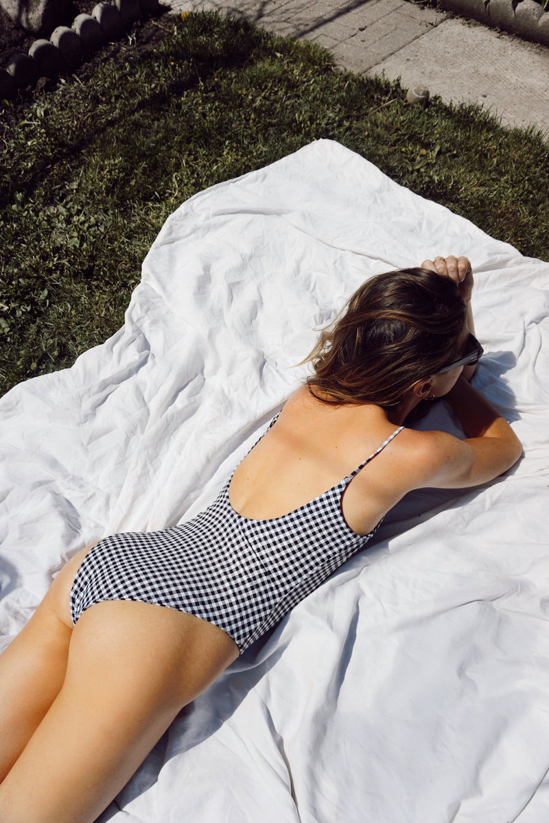 Alexandra Rabbitte wears Canadian swim brand Prairie Swim classic black and white gingham low back one piece swimsuit