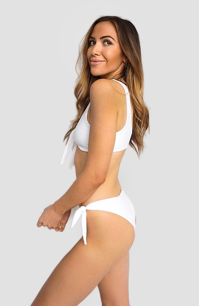 Alexandra Rabbitte in Canadian swimwear brand Prairie Swim cute white adjustable, mix and match, tie-front bikini top with supportive straps for all bust sizes