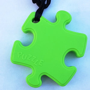 Puzzle shaped sensory chew with cord