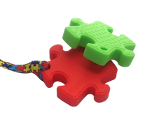 Load image into Gallery viewer, Puzzle shaped Chew with lanyard
