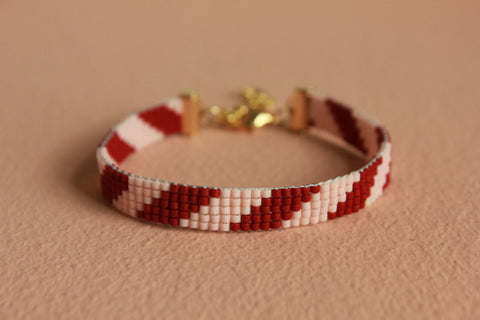 LOOM armbånd (stribet rosa/bordeaux)