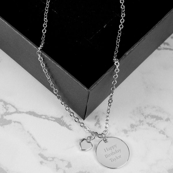 Silver Coloured Disc and Heart Charm Necklace lifestyle image