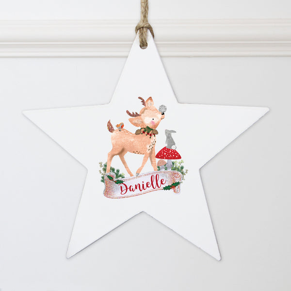 Personalised Festive Fawn Wooden Star Decoration lifestyle image
