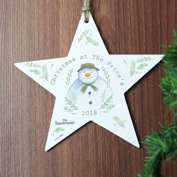 Personalised The Snowman Winter Garden Wooden Star Decoration lifestyle image