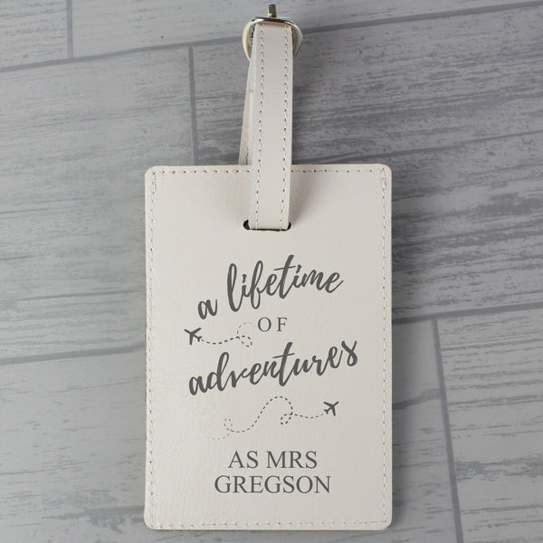 Personalised 'Lifetime of Adventures' Cream Luggage Tag lifestyle image
