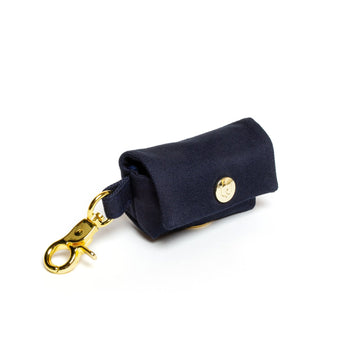 simple navy poop bag dispenser with gold accent