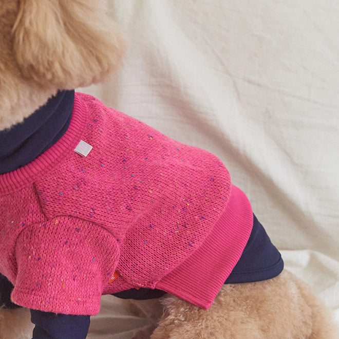 Toy poodle wearing Dodu Knit dog sweater in Rose