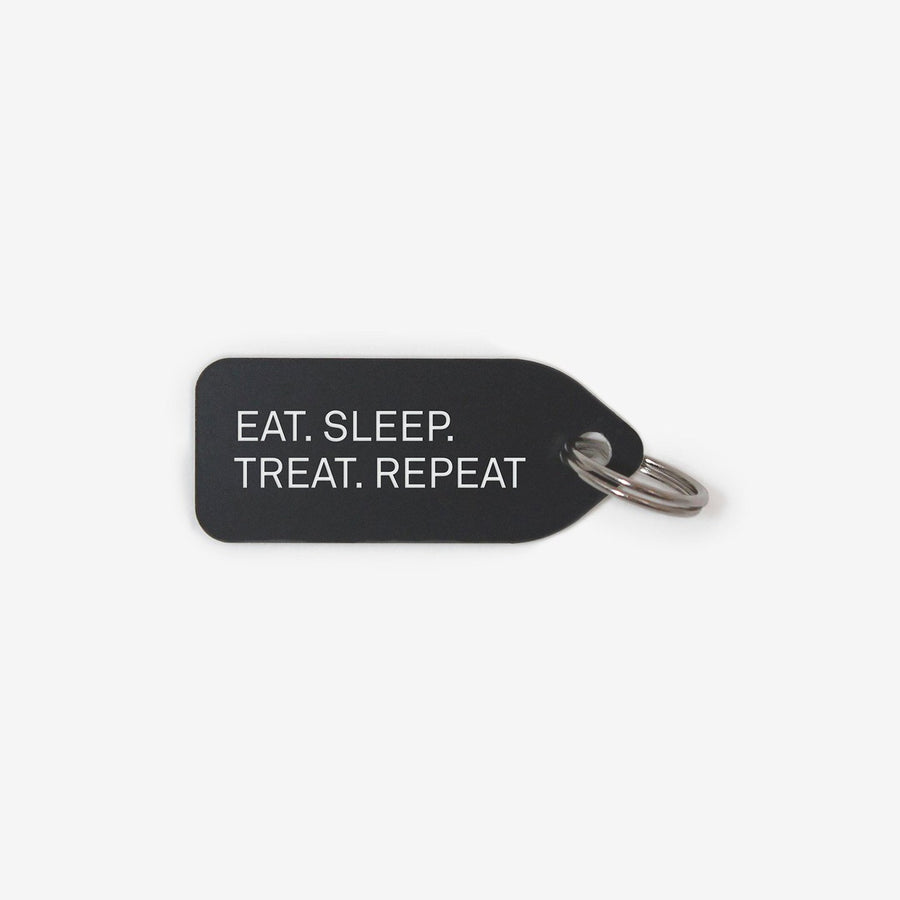 Eat. Sleep. Treat. Repeat. Dog Tag in Black