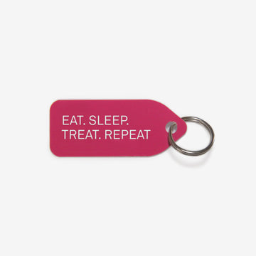 Eat. Sleep. Treat. Repeat. Dog Tag in Pink