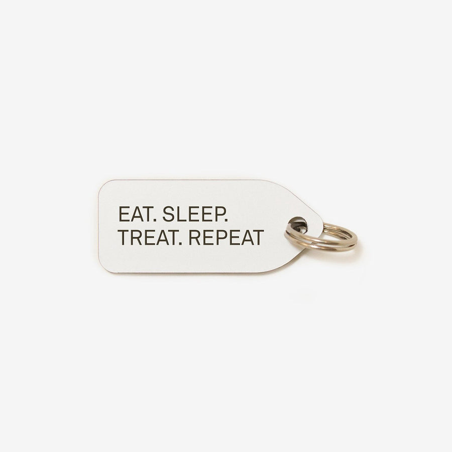 Eat. Sleep. Treat. Repeat. Dog Tag in White