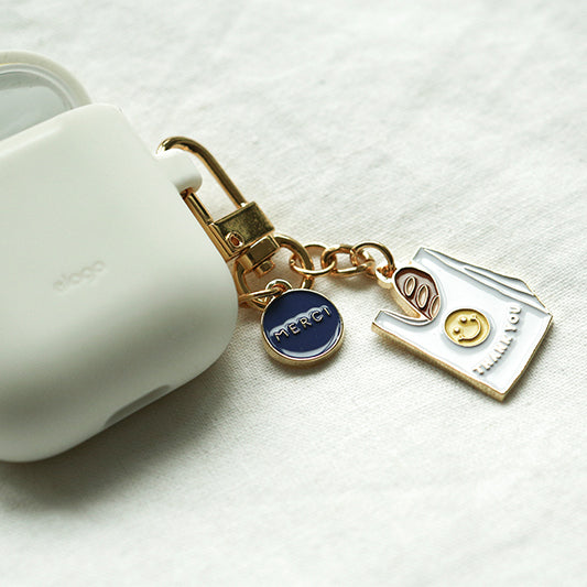 happy face AirPod keychain