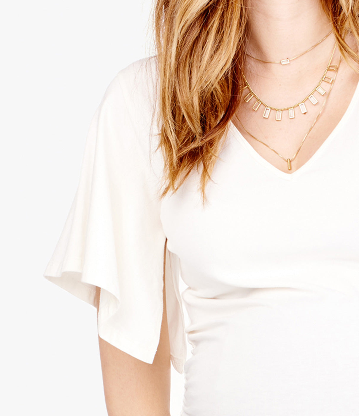 In The DetailsFun flutter sleeve for an unexpected fashionable twist on a classic Tee.