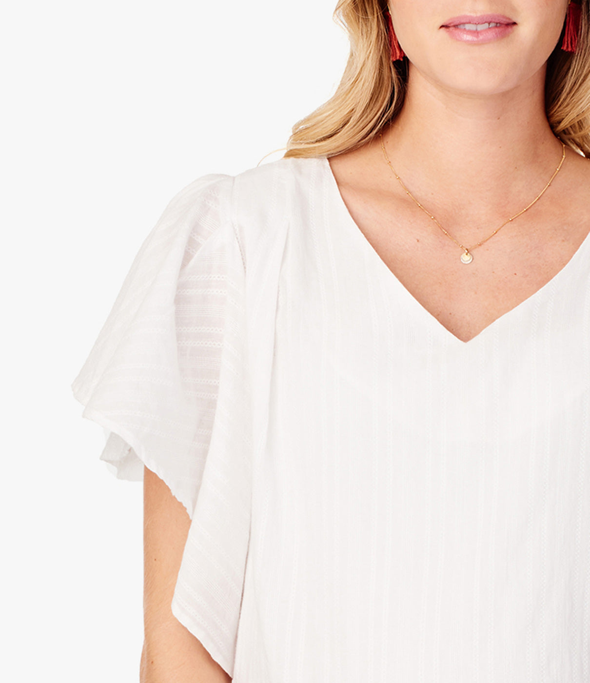 Fashion + FunctionFlutter sleeves offer flattering arm coverage.