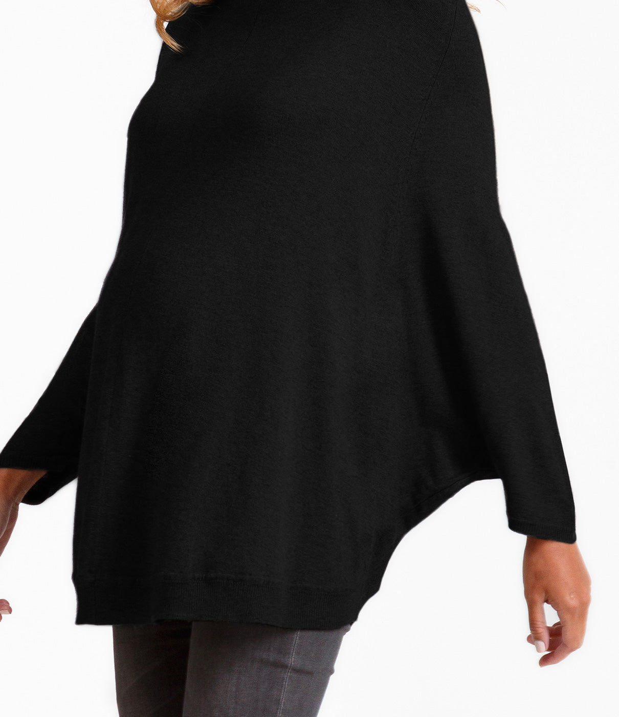 Fashion + FunctionA longer sweater style and batwing poncho sleeves provide maximum backside and arm coverage.