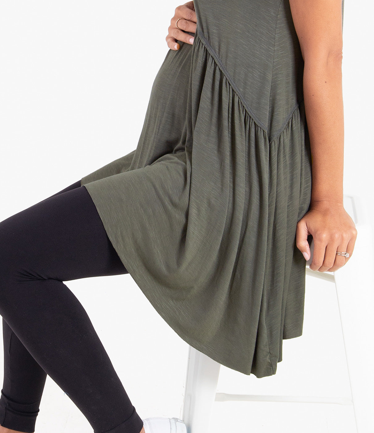 Fashion + FunctionA drapey, handkerchief hem is a fun play on a basic tee, and creates a drape that can be worn with any form fitting bottom.