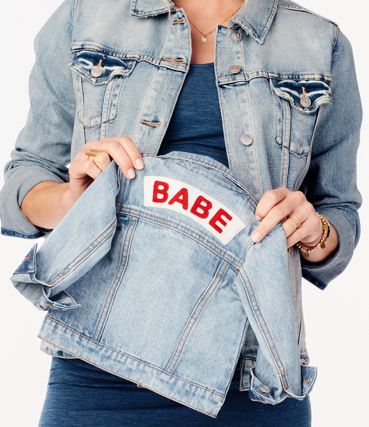 """In the DetailsChain-stitched """"Babe"""" felt patch on back."""