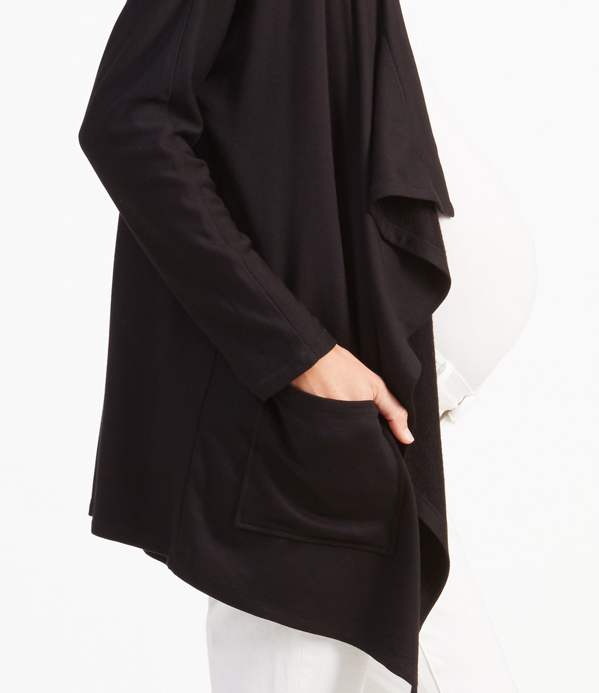 FASHION + FUNCTIONFlattering dolman sleeves for added arm coverage and handy front pockets.