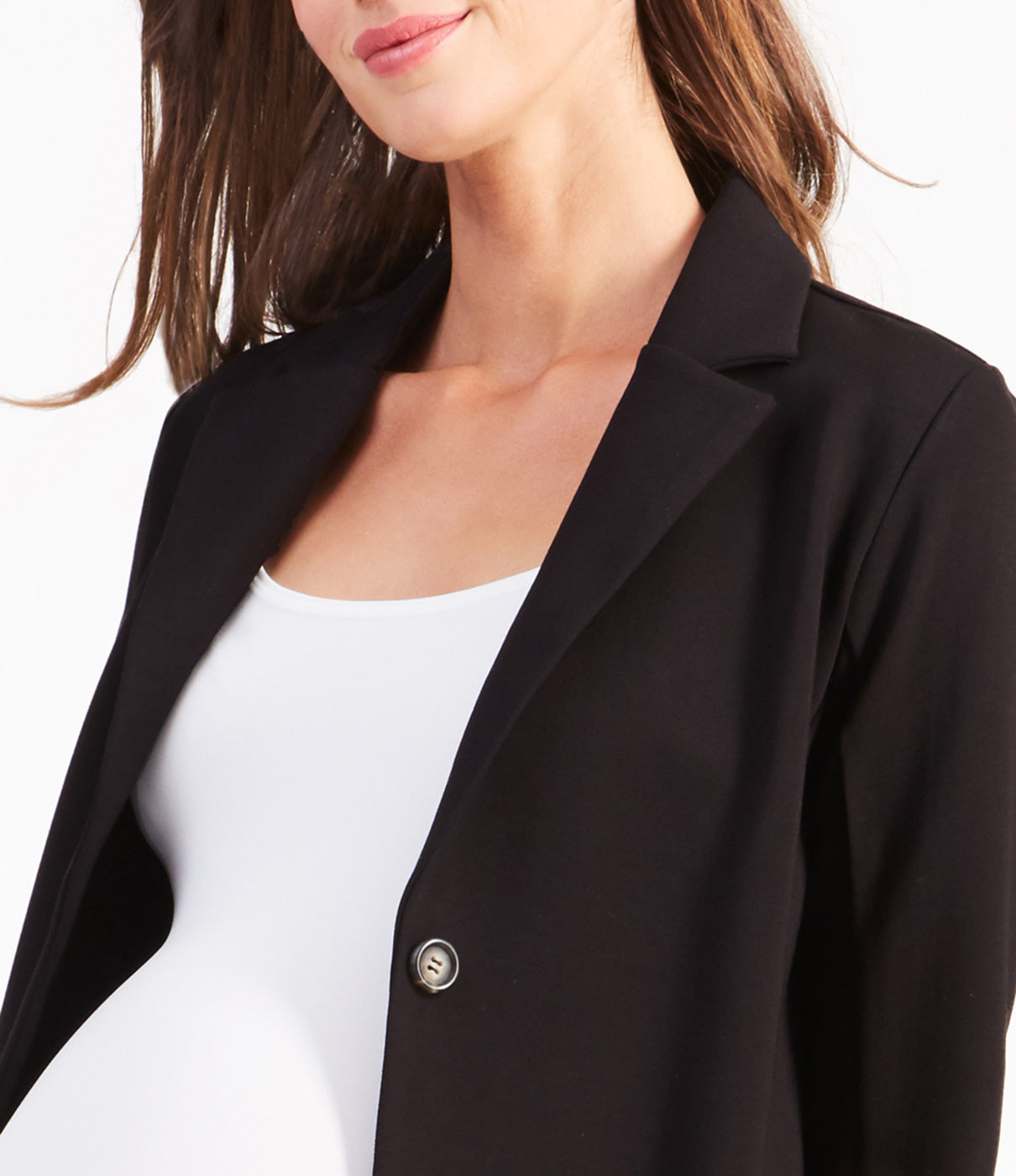 In The DetailsFeatures a slim lapel and single button closure.