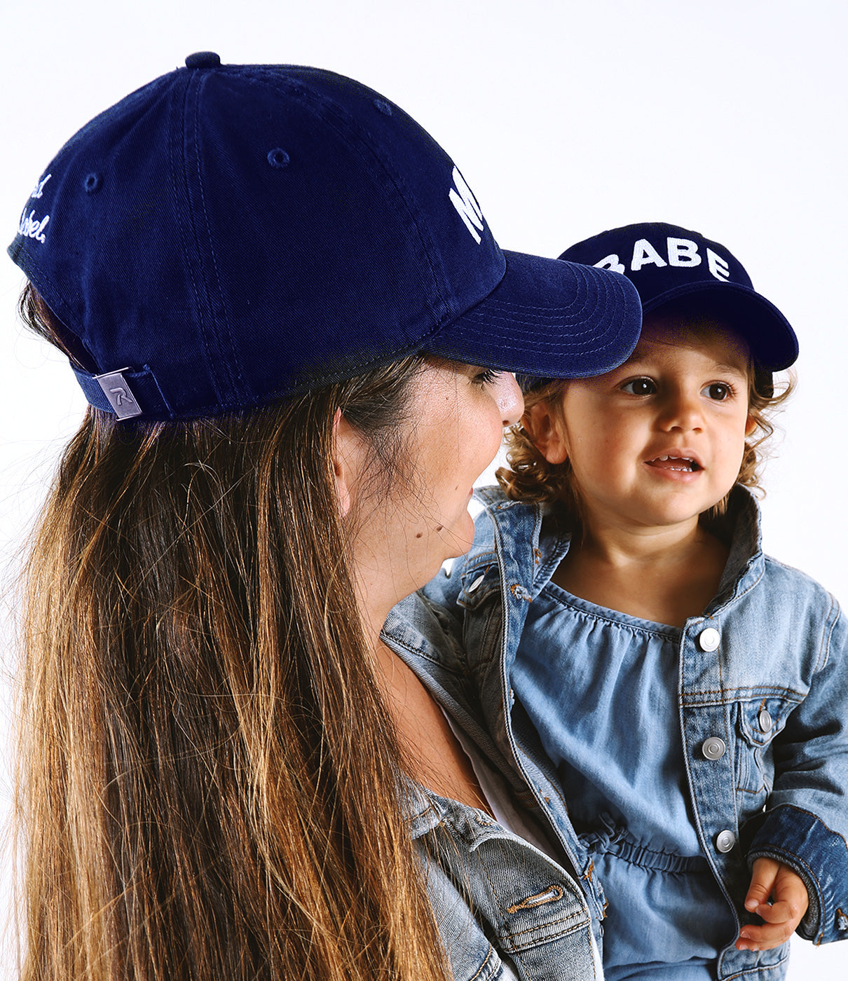 FIT FACTSMama hat features an adjustable Cloth Backstrap with bronze colored Buckle. Babe hat features a stretch fit elastic strap that fits most 12 month olds and up to 3T!