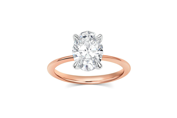 Oval Cut Four Prong Engagement Ring