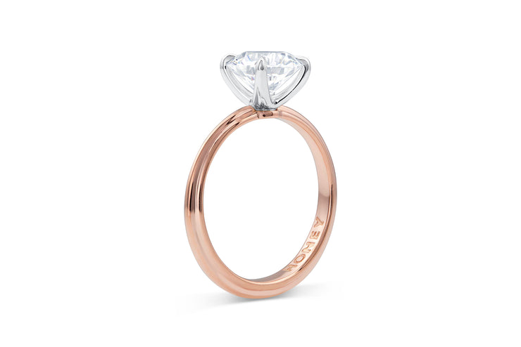 Classic Round Cut Solitaire Engagement Ring in Rose Gold