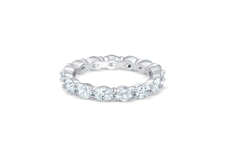 East West Wedding Band with Eternity Oval Cut Diamonds in White Gold