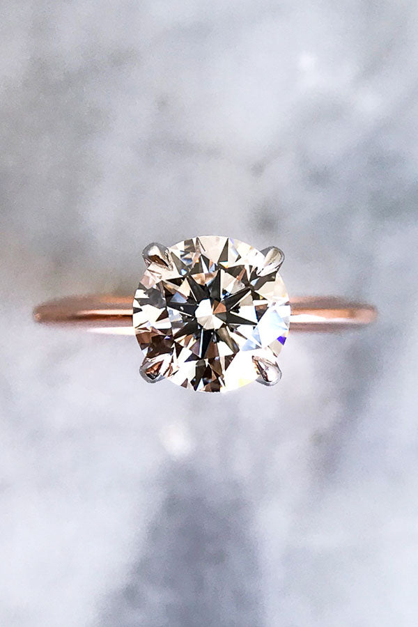 Simple Round Cut Diamond Engagement Ring in Rose Gold