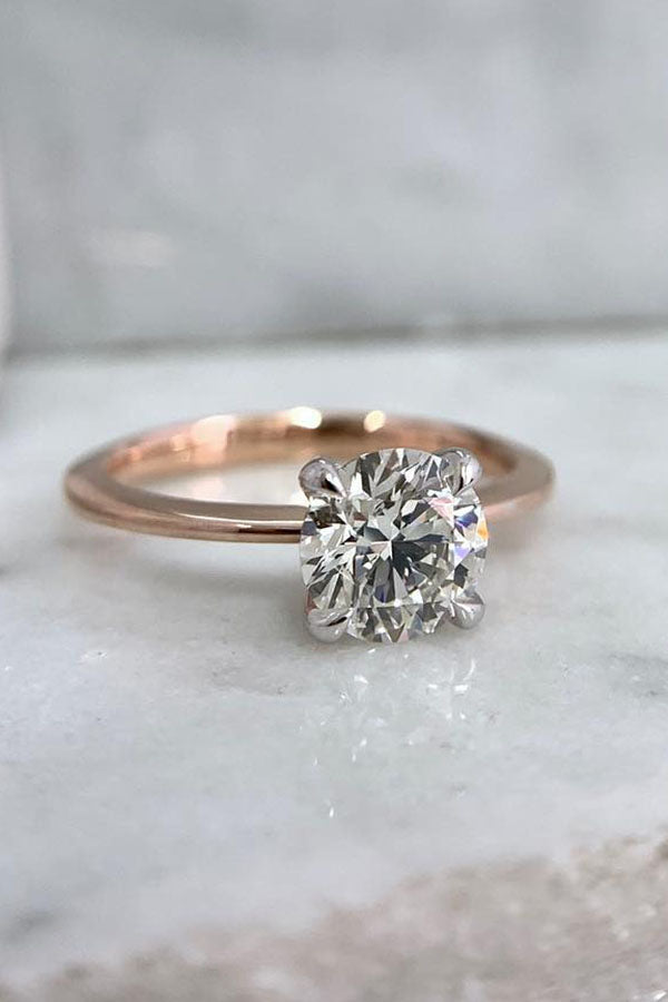 Four-Prong Oval Solitaire Engagement Ring