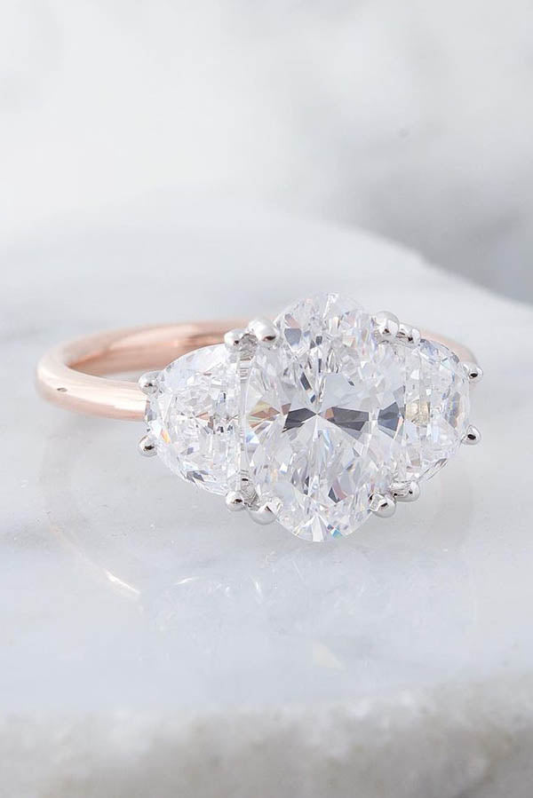 Dainty Three-Stone Engagement Ring with Half Moon & Oval Diamonds