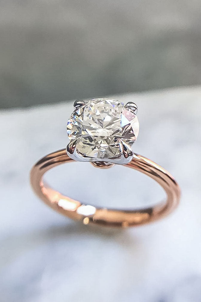 Simple Solitaire Engagement Ring with Round Cut Diamond