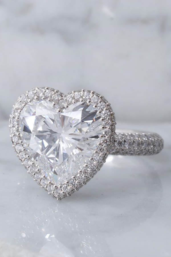 Round Cut Engagement Ring with Assymetric Diamond Clusters