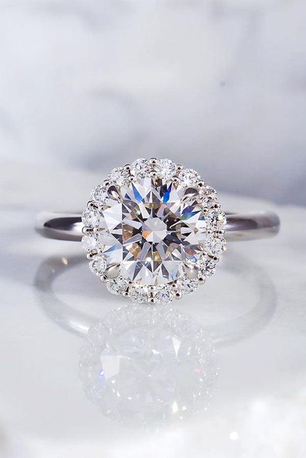 Simple Round Halo Engagement Ring in White Gold