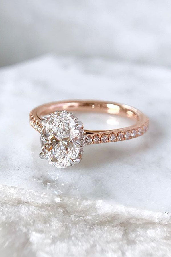 Oval Graduated Cathedral Engagement Ring