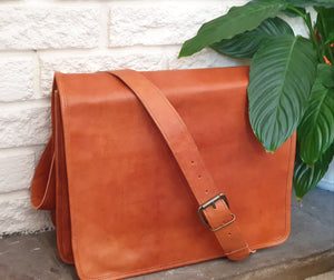 These fabulous handmade messenger bags are designed by us and made for us in Pushkar, India. Perfect for college, uni, work, school  or just to be stylish! They fit a full size laptop as well as tablet, phone, folders etc. www.karmaripon.co.uk