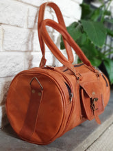 Load image into Gallery viewer, These fabulous handmade leather barrel bags are made for us in Pushkar, India.  Perfect for a sports bag, hand bag or just to be stylish! www.karmaripon.co.uk