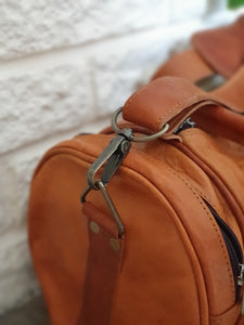 These fabulous handmade leather barrel bags are made for us in Pushkar, India.  Perfect for a sports bag, hand bag or just to be stylish! www.karmaripon.co.uk