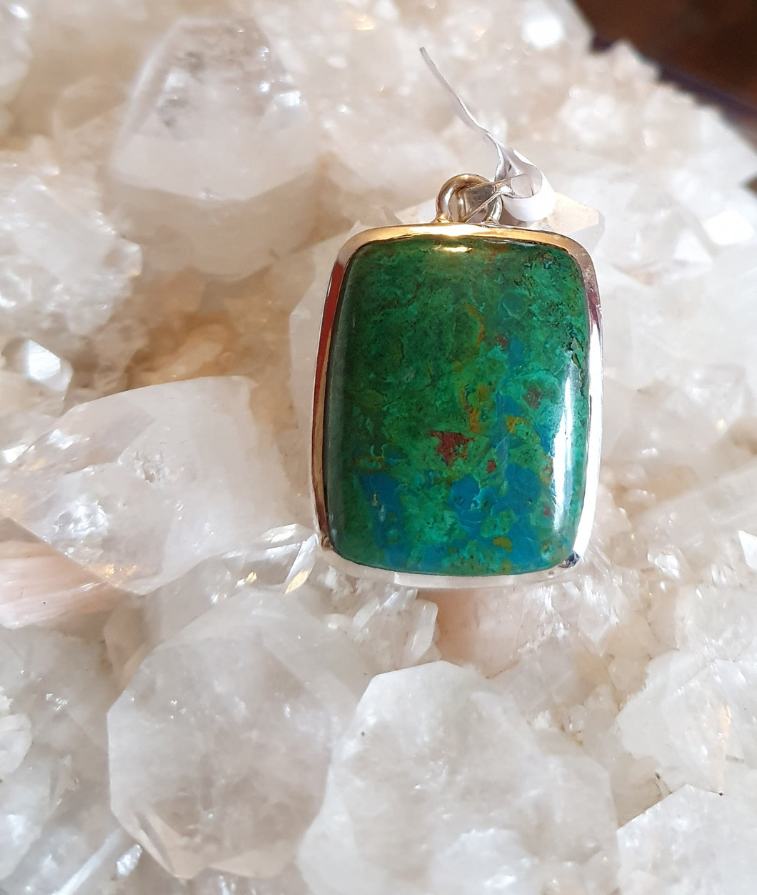 Chrysocolla Pendant set in Silver