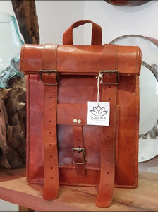 These fabulous handmade leather roll top back packs are made for us in Pushkar, India. Perfect for school, college, laptops or just to be stylish! www.karmaripon.co.uk