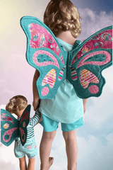 Girl and doll wearing butterfly wings made by sewmuchonline