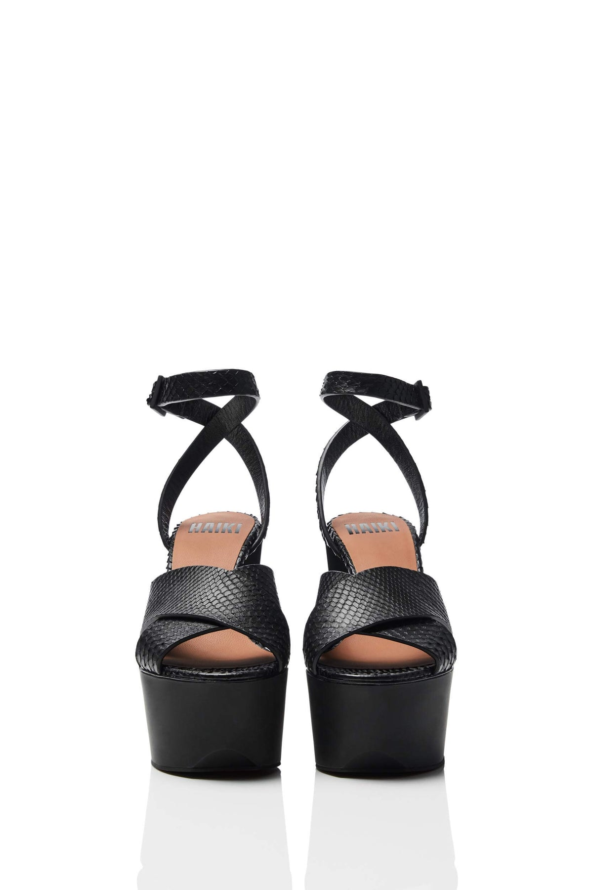 HAIKI 601 - Wide band, crisscross sandal, with self-adjusting ankle strap. Classic Genuine Python with hand-coated edges in black.