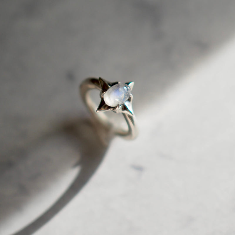 Ethically mined stardust moonstone ring set in sterling silver from Iron Oxide Designs.
