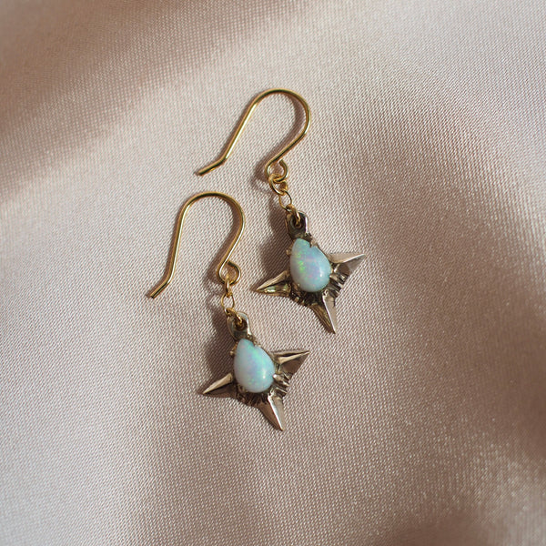 Teardrop shaped lab grown opal set in 4 point star setting in gold tone bronze handmade by Iron Oxide Designs