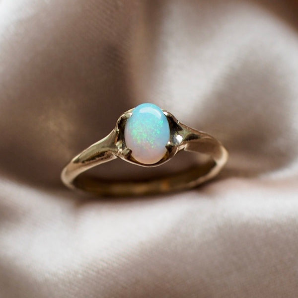 gold tone bronze ring set with an ethically sourced opal in a classic setting by Iron Oxide Designs