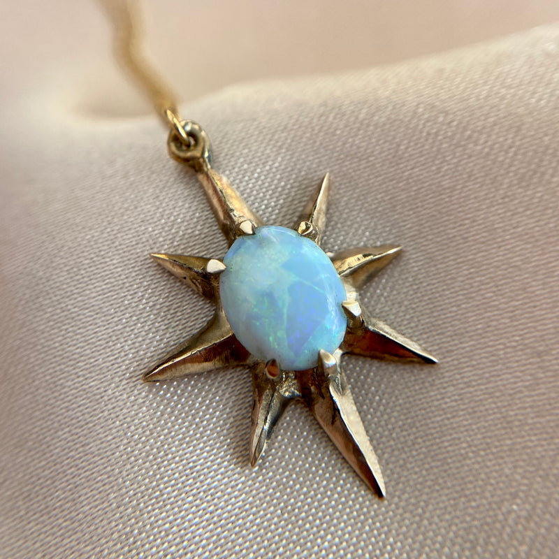 Close up of Supernova large star necklace set with lab grown opal