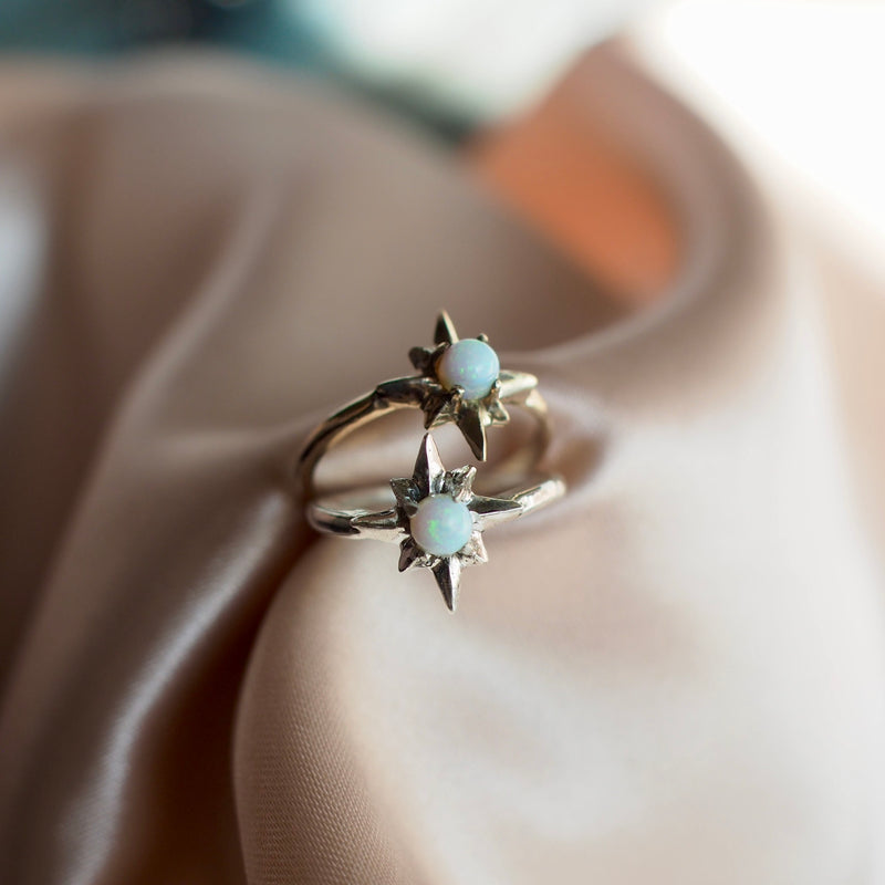 Polaris north star ring set with a tiny lab grown opal in sterling silver and gold tone bronze handmade by Iron Oxide Designs
