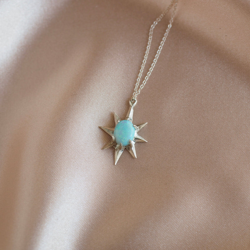 Close up of Supernova large star necklace set with lab grown opal in sterling silver