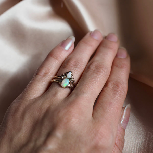 Sustainable Wedding and Engagement stacking ring set featuring ethically sourced opals by Iron Oxide Designs on a model