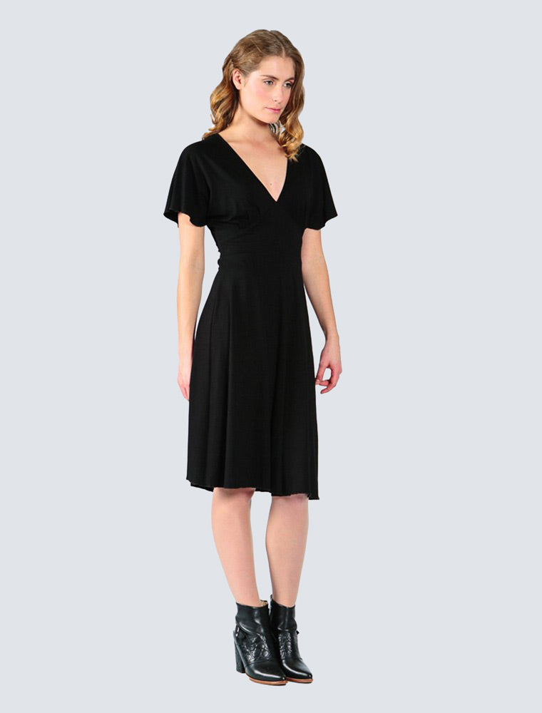 Feminine black jersey dress with A-shaped hem by LILLE