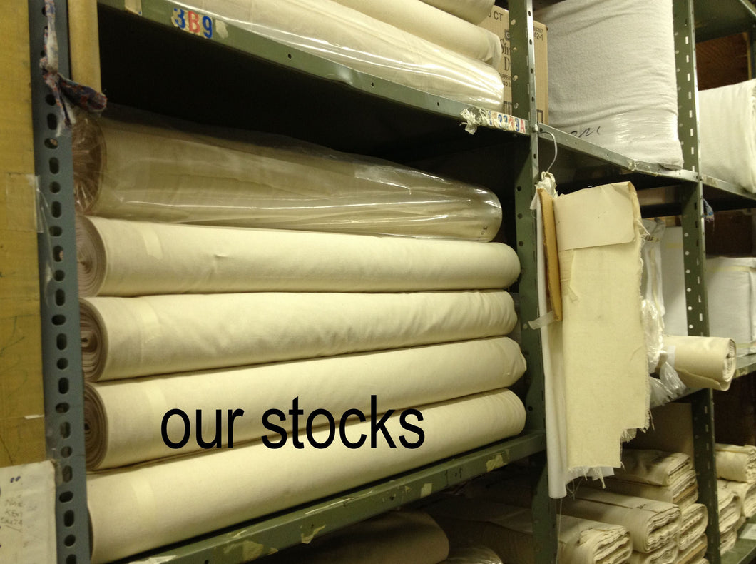 stocks of unbleached muslin on shelves